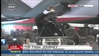 Raila Odinga performs a song to praise the Late Otieno Kajwang