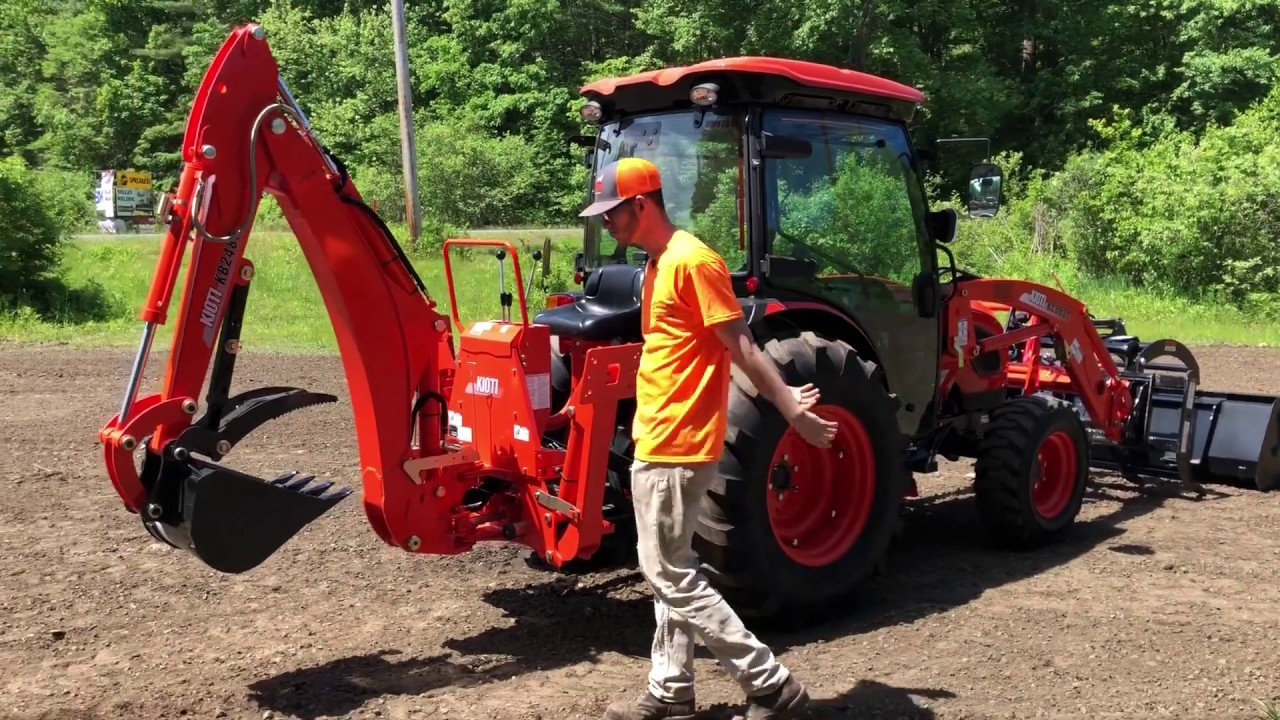 Kioti DK6010SE HST Cab Tractor w/ Loader & Backhoe & Grapple - New Tractor  Walkover