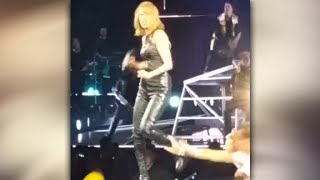 Taylor Swift gets spooked by fan during show