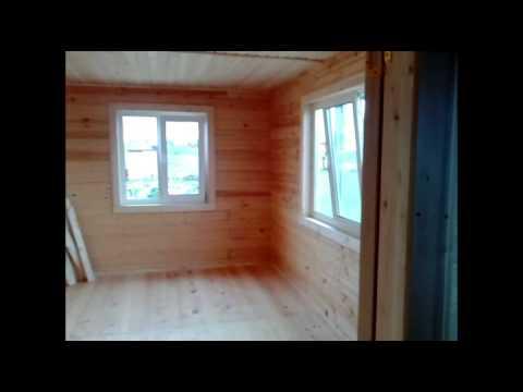 видео: Красивый брусовой дом с эркером 9х11