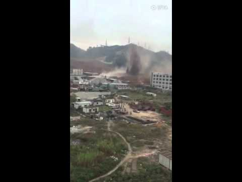 A landslide occurred on Dec 20 in S China's Shenzhen has buried some 22 buildings