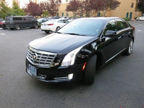 Cadillac XTS 2014 на русском