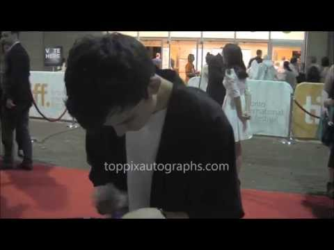 Asa Butterfield - Signing Autographs at the 2014 Toronto International Film Festival