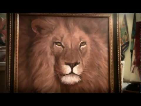 Russian Bob Ross. the most famous Russian artist Igor sugars. Portrait of a lion