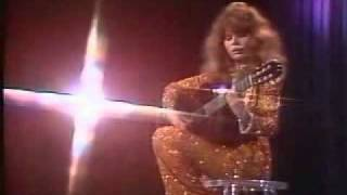 Charo performs Recuerdos de la Alhambra on her Guitar.avi