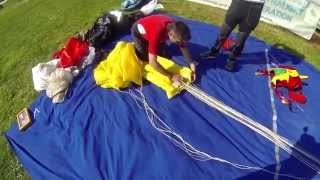 Flat packing a parachute