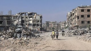 Street by street, gutted Syrian town begins reconstruction