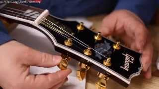 AGuitar Builder Looks at a Chinese made FAKE Gibson Supreme Chibson Guitar