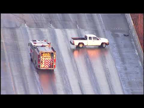 Vehicles sliding on icy Houston freeways