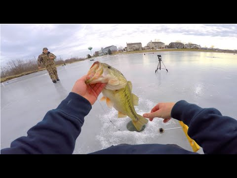 Handlining winter bass tip up ice fishing youtube for Ice fishing for bass