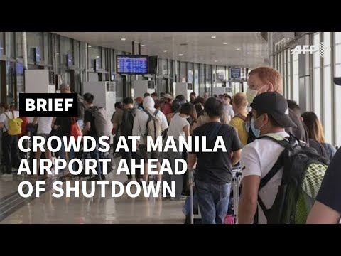 Passengers rush to Manila airport ahead of planned virus shutdown | AFP