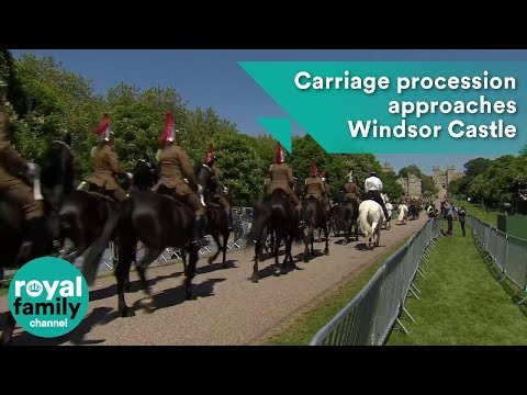 Carriage procession approaches Windsor Castle during full dress rehearsal for Royal Wedding