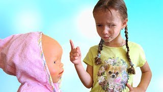 Ulyana teaches doll to eat healthy food and exercise