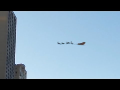 Santa Claus Caught On Tape Flying In His Sleigh Pulled By His Reindeer
