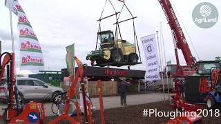 A Krone BiG X and an Amazone Pantera being lifted back into position...at 'Ploughing 2018'