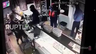 Russia  Gun wielding robber no match for this determined beer drinker