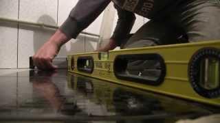 Укладка керамической плитки на пол в ванной