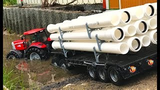 BRUDER TRACTOR McCormic Construction Company transport pipe!