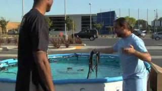 Kobe Bryant Jumps Over Pool w/ Snakes (Black Mambas?)