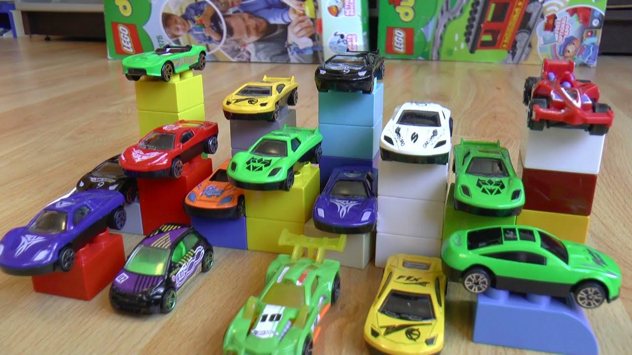 Машинки мультики Играем в машинки игрушки Шевроле и сооружаем препятствия из машин