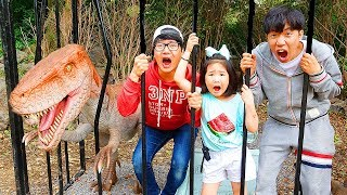 Boram and Konan Ddochi play with dinosaur at Forest Safari