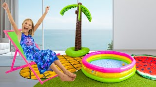 Amelia and Avelina have fun with inflatable toys