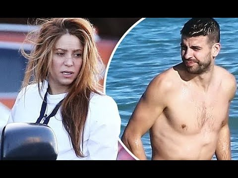 shakira-bundles-up-while-hunky-footballer-beau-gerard-pique-strips-down-for-a-christmas-eve-swim-in