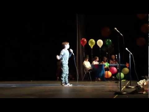 Matthew singing Queen's We are the Champions at Lowes Island Elementary School's 2012 variety show