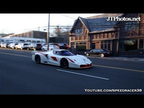 Ferrari FXX EVO driving on a public road
