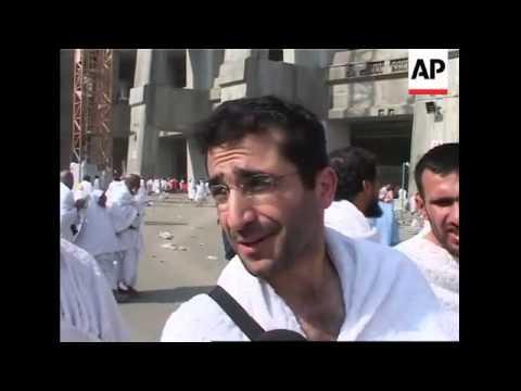 Hajj pilgrims stone symbol of devil, celebrate feast