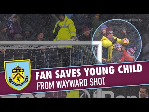 Fan SAVES Young Child From Wayward Shot