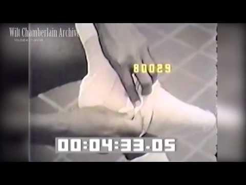 Oscar Robertson taking care of his feet