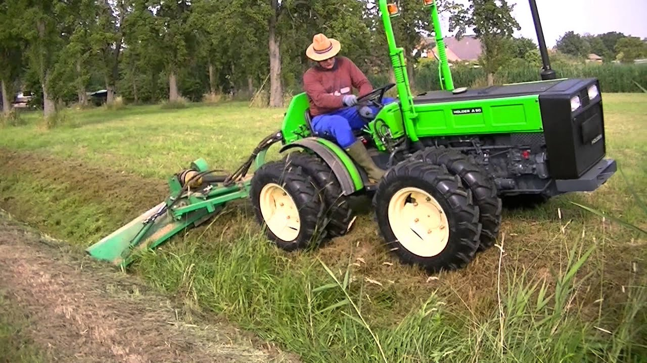 Allradschlepper Knicklenker Traktor Holder A50 im Einsatz mit GEO Mulcher - YouTube