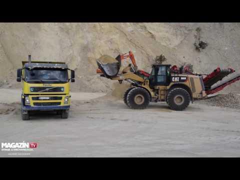 CAT 966K wheel loader loading Volvo FM440