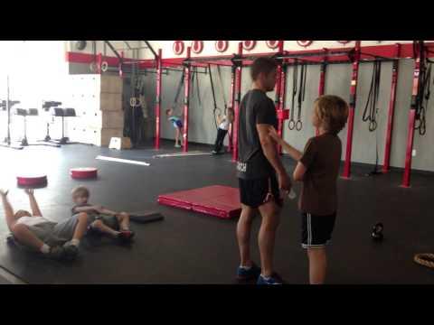 Dan coaching the kids on the proper KB Deadlift form