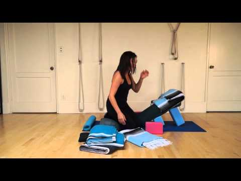 restorative yoga supported reclined pose with the use of