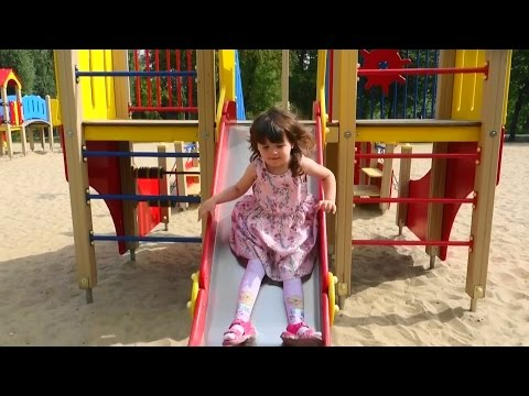 Kids playground with slide, carousel and other toys Children playing on the playground