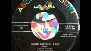 Joan Shaw (Salena Jones) - hand holding baby