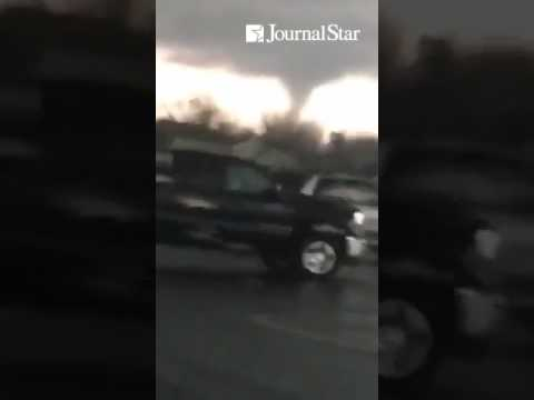Funnel cloud footage by Jorgeanne Schramm from the Parkside Middle School parking lot in Peru, Ill.