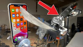 IPHONE 11 vs ROBOT ARM w/ KATANA vs GALAXY S10