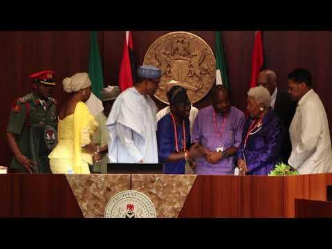 Award presentation to President Buhari by Dr. Naomi Ruth B. King