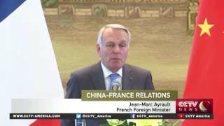 Chinese, French foreign ministers discuss trade and market economy status