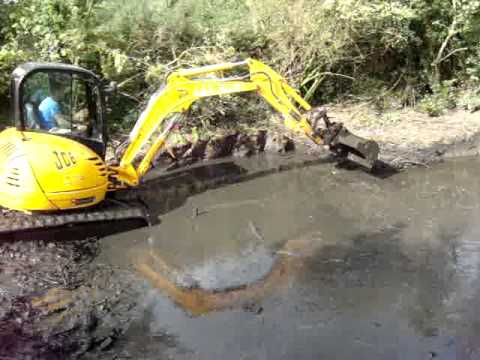 Cleaning out a farm pond youtube for Farm pond maintenance