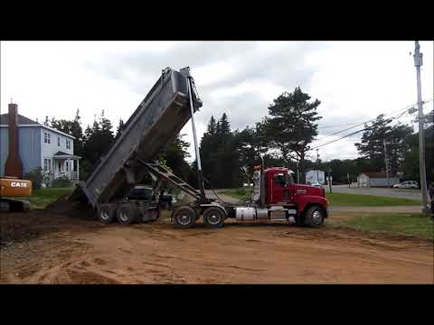 Mack End Dump Hauls To Case Excavator