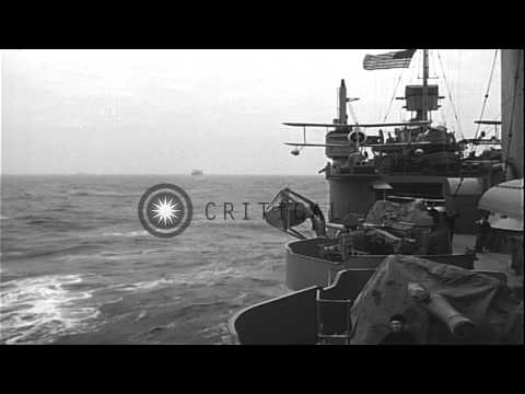 Submarine tender of Atlantic convoy with about six submarines tied up alongside i...HD Stock Footage