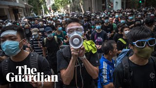 Thousands gather outside police HQ in renewed Hong Kong protests
