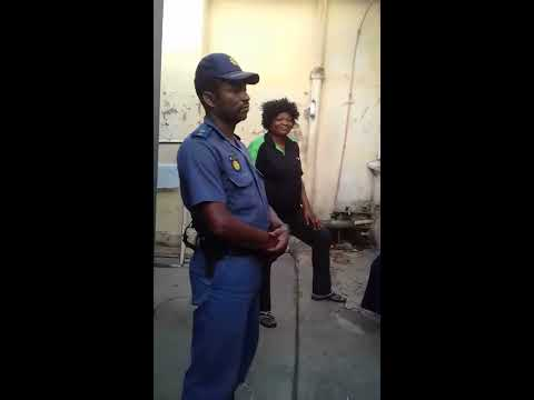 Police Officer Colonel Wiseman Sithole doing rental collection