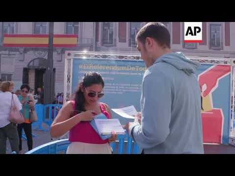 Anti-referendum protesters hold mock ballot in Madrid