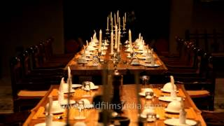 Luxurious long wooden dinning table at Kanha Earth Lodge