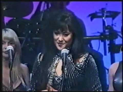 Asia Carrera wins Female Performer of the Year at the 1995 AVN Awards.